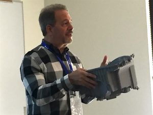 Ed Israel shows large part manufactured via Additive Manufacturing.